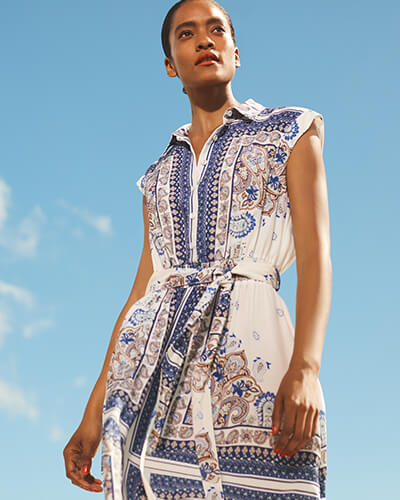White, cap sleeve, button-through dress with blue and brown paisley print and matching fabric belt