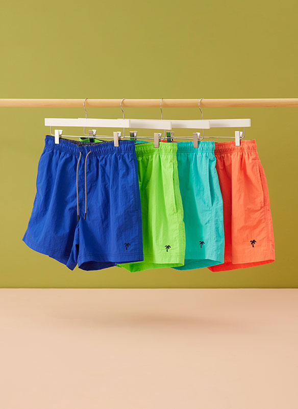 Choice of swim shorts in cobalt blue, fluorescent green, turquoise, and orange