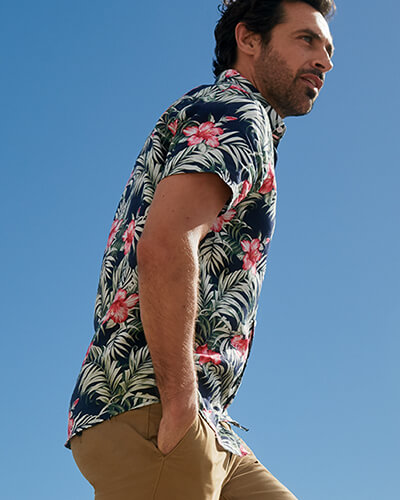 Short sleeved, navy shirt with pink flowers and white leaf pattern
