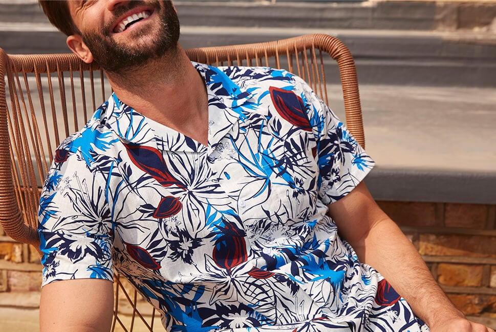 Short sleeved off white shirt with dark blue, blue and red floral print