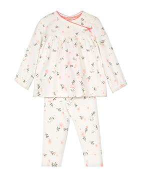 Pale pink PJs with pattern featuring pink flowers, leaves and small grey puppies, and pink bow and pink-edged neckline