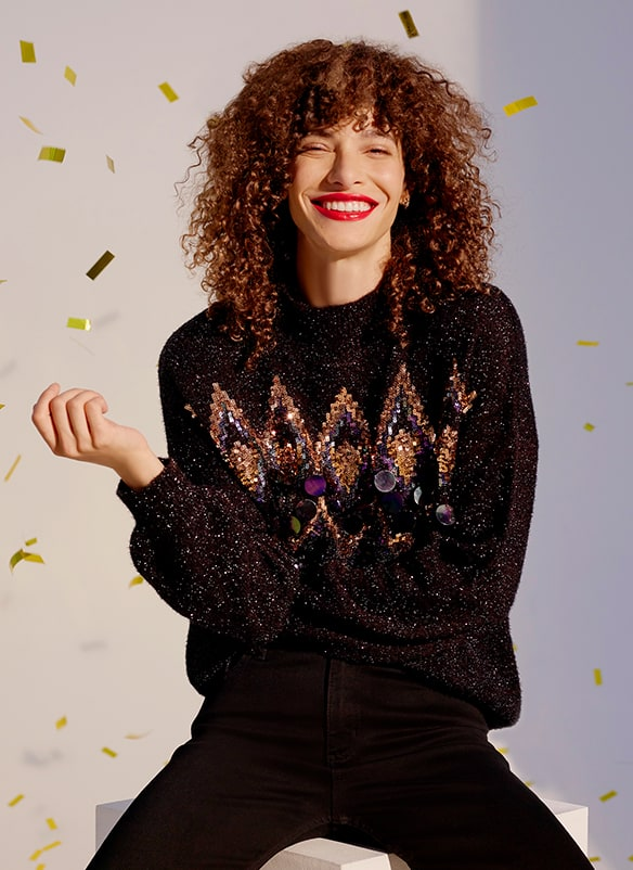 Black sparkly jumper with bronze and silver sequin pattern and large sequin detail