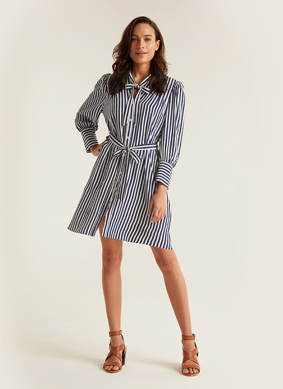 Smart, knee length, black and white stripe, button-through blouse dress with fabric tie at the neck and fabric tie belt