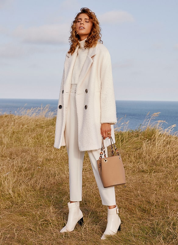 White, double breasted knitted coat with dark buttons
