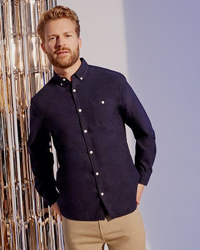 Long sleeve navy shirt with white buttons