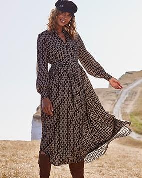 Long-sleeve flowy midi dress with cinched waist
