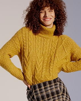 Chunky roll neck jumper with cable knit detail