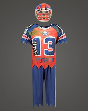 Short sleeve red and blue mock American football top and trousers with jagged hems, skull and crossbones motif, the number 13 and the word 'horror'. Comes with a mock helmet