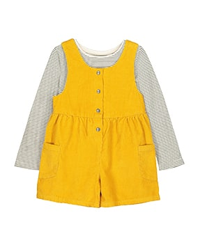 Mustard yellow, sleeveless cord playsuit with side pockets, paired with long sleeve grey and white stripe top, and oatmeal tights