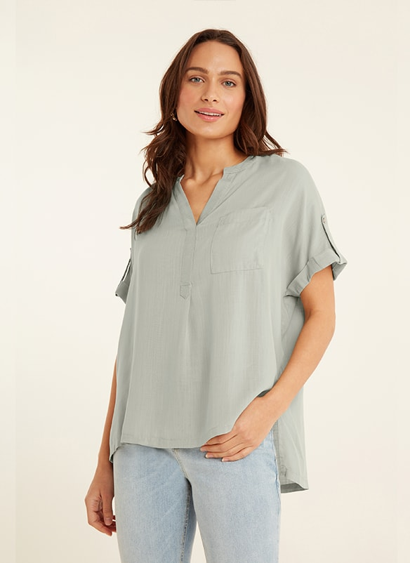 Pale sage green, loose fitting, v neck, pull-on shirt with button-up short sleeves