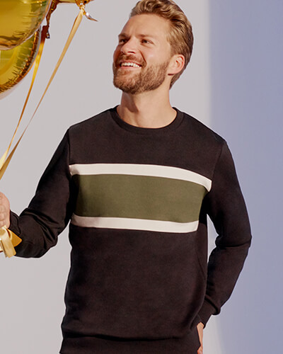 Black sweater with grey block stripe, edged with thinner white stripes across chest