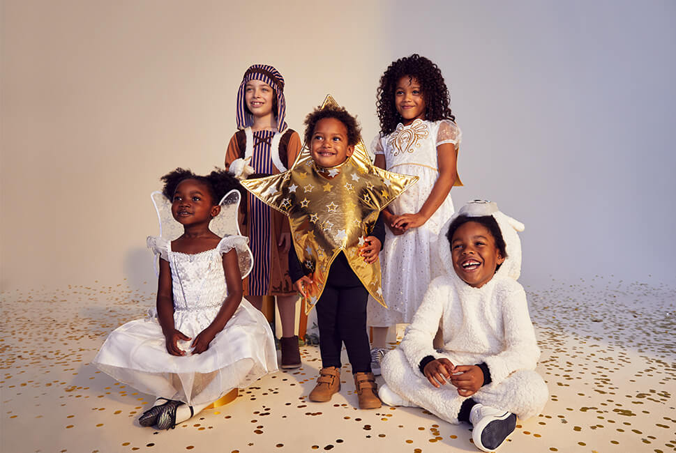 White fairy dress with wings; stripey shepherd costume with matching headdress; shiny gold star costume with star print; white angel dress with angel wings; white fleece sheep onesie with sheep head hood