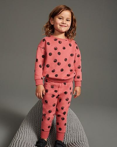 Raspberry pink sweatshirt with large dark, potato print-style spots