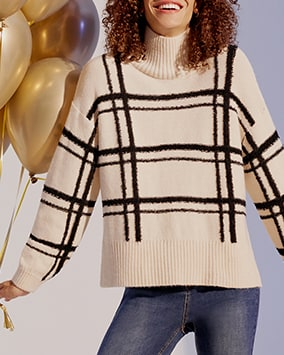 Cream jumper with high rib turtleneck and widely spaced black checks