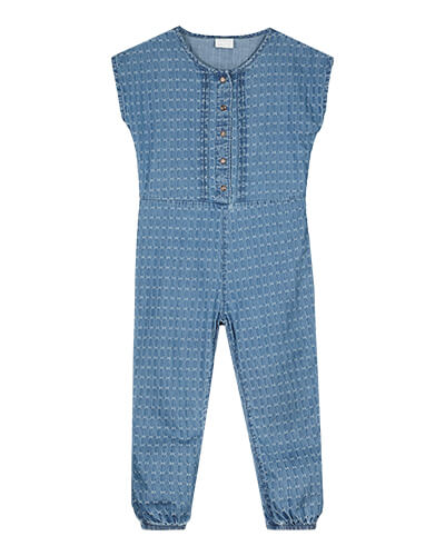 Sleeveless blue denim jumpsuit with allover white cross pattern, front buttons and elasticated ankles