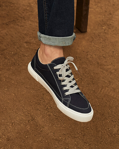 Navy canvas trainers with white laces and sole