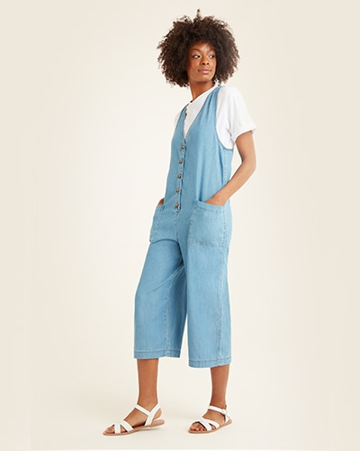 Sleeveless, v-neck, light blue denim, calf length jumpsuit with button front and 2 pockets