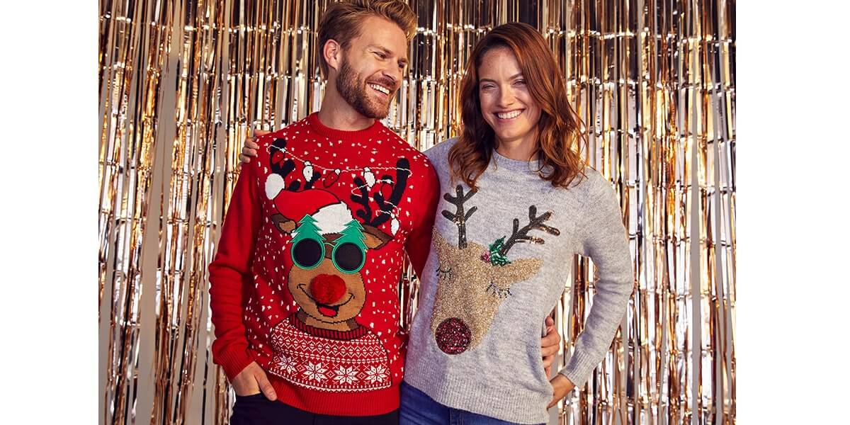 Jumper 1 is red with white snowflakes, with Rudolph with a red pom pom nose, wearing a Santa hat and Christmas tree-shaped sunglasses. Jumper 2 is grey with a glittery Rudolph face and sequin antlers