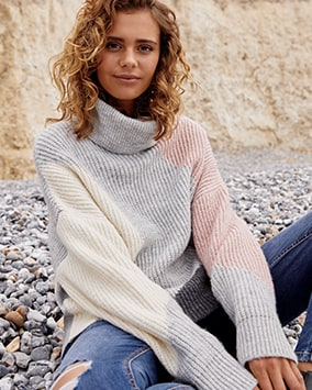 White, grey and pastel pink roll neck knit jumper
