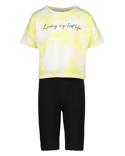 Yellow and white tye-dye top with the words 'Living my best life' in black stitching, and black shorts