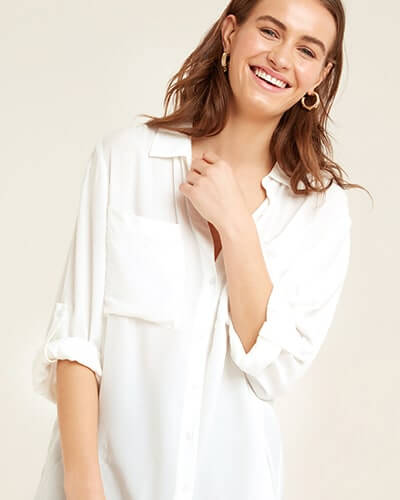 Loose fitting, white, v-neck shirt with button-up sleeves and chest pockets