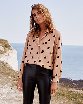 Neutral beige blouse with black spot pattern and chest pockets