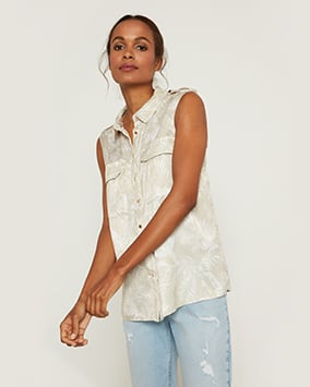 Stone coloured sleeveless shirt with white leaf pattern