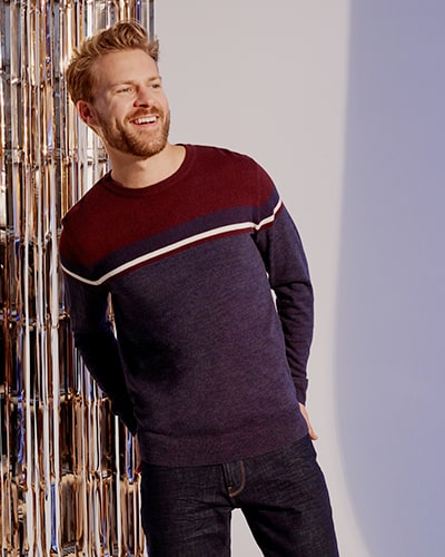 Navy jumper with maroon yoke and a thin white and maroon stripe across chest and arms