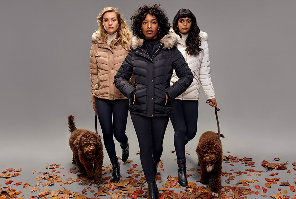 Padded jacket in 3 colourways: camel, black, bone white, with fur-lined hood and zipped pockets