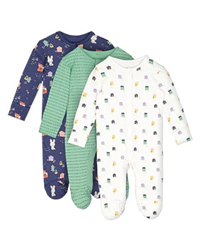One white sleepsuit with colourful house print; one navy sleepsuit with colourful house, bunny, fox and tree print; one mint green sleepsuit with dark flecks