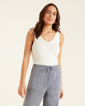 Ivory, longline, rib knit vest top. Loose fitting, grey marl trousers with drawstring elasticated waist