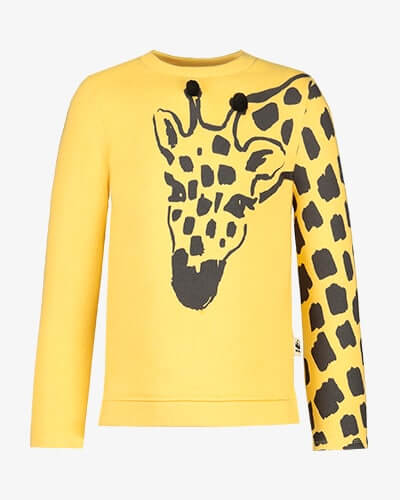 Yellow sweater with large giraffe print across left sleeve and chest, with black pom-poms on the ossicones