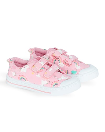 Pink plimsolls with unicorn and rainbow print, twin velcro straps and white toe and sole