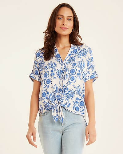 Cream, short sleeve, button-through, tie-front blouse with sky blue floral print