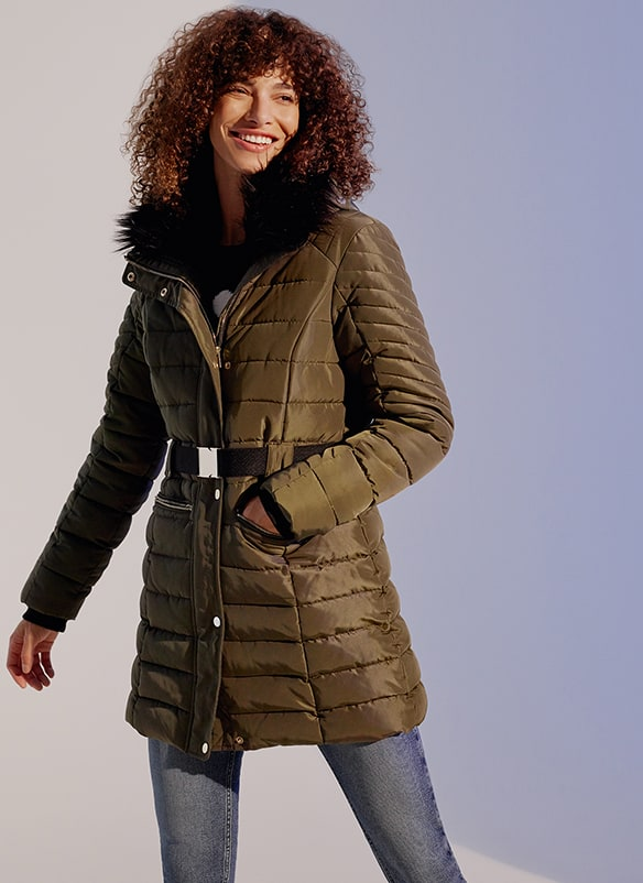 Fitted, quilt-stitched, padded zip-up coat with popper buttons and buckled belt. Hood has a furry black lining