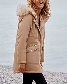 Toffee brown parka-style coat with 2 popper and zip pockets and drawstring furry-lined hood