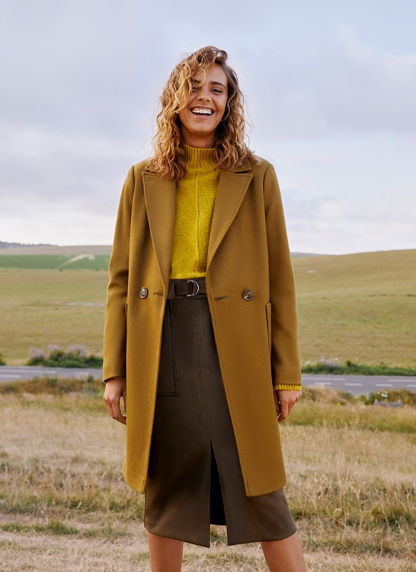 Double-breasted, 2-button olive green coat with revere collar and 2 deep pockets