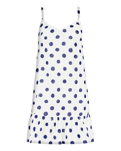 Sleeveless white dress with navy spots, shoulder straps and gathered hem