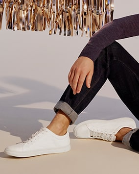 Plain white lace-up trainers