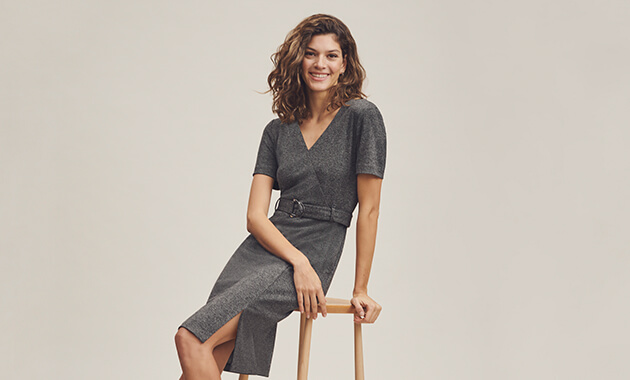 Dark grey knee length, slimline dress with short sleeves, wrapover style front, side split and matching belt