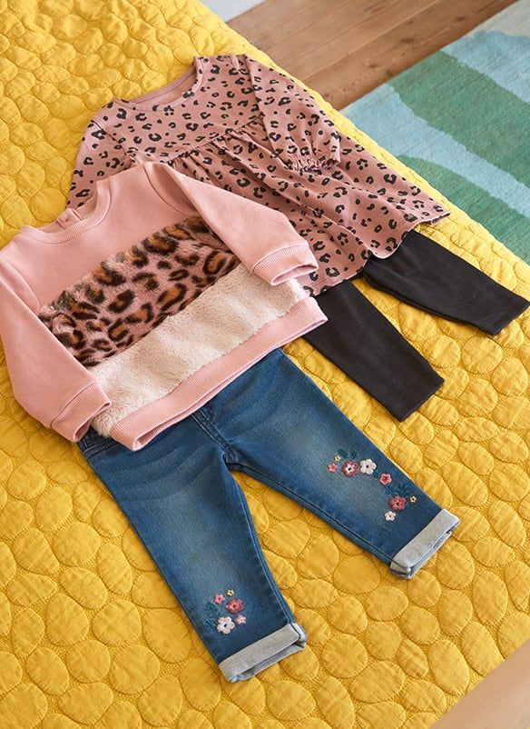 Pale pink sweater with pink leopard print and cream fleece block stripes