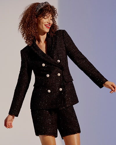 Black bouclé blazer with jeweled buttons and matching shorts with frayed hems
