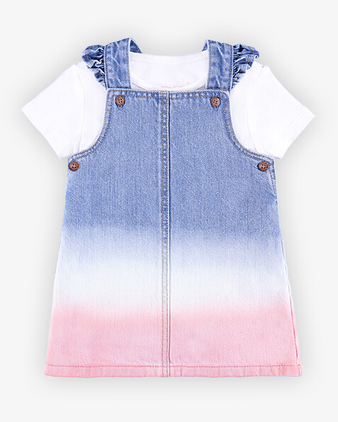 Denim pinafore with white and pink tie dye detail on bottom half of dress, and ruffle edging on shoulder straps. Comes with short sleeve white T-shirt