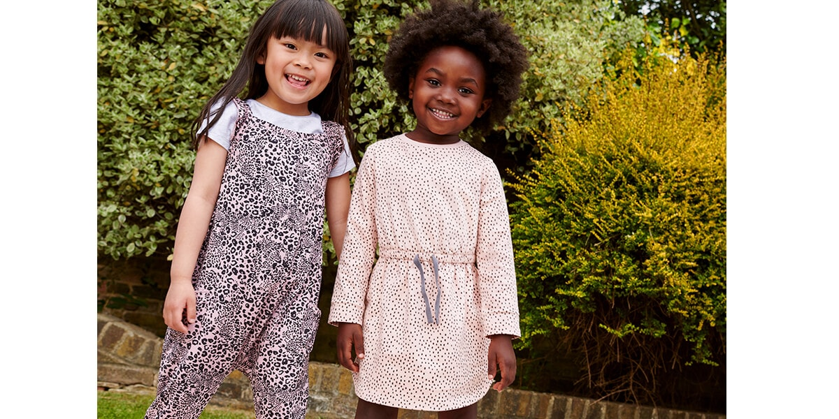 Sleeveless light pink with black leopard print jumpsuit, and light pink sweater dress with shimmery spots and drawstring waist
