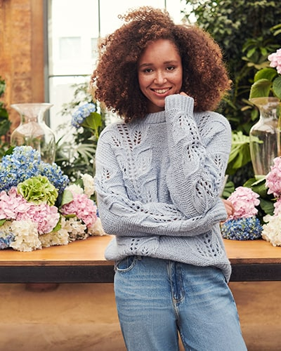 Ladies' light cornflower blue jumper with leaf knit design