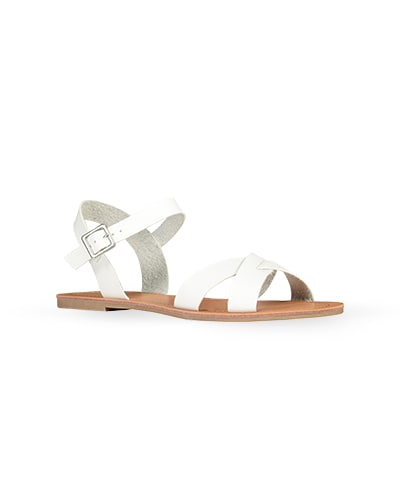 Flat sandals with crossover straps and buckle strap at ankle
