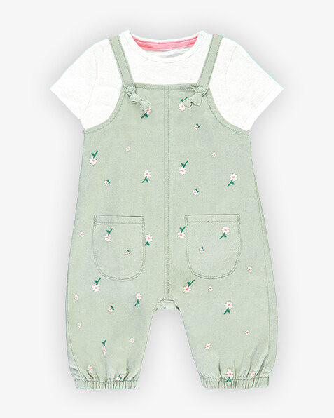 Pistachio green dungarees with daisy print and elasticated ankles. Comes with short sleeve white T-shirt