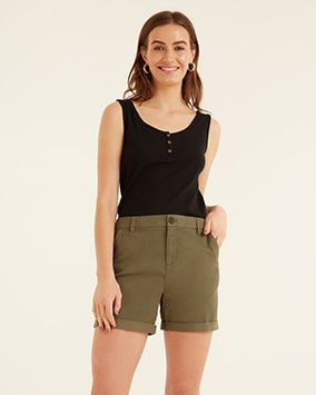 Black vest top with wide shoulder straps and 3 buttons. Khaki shorts are smart with belt loops and side pockets