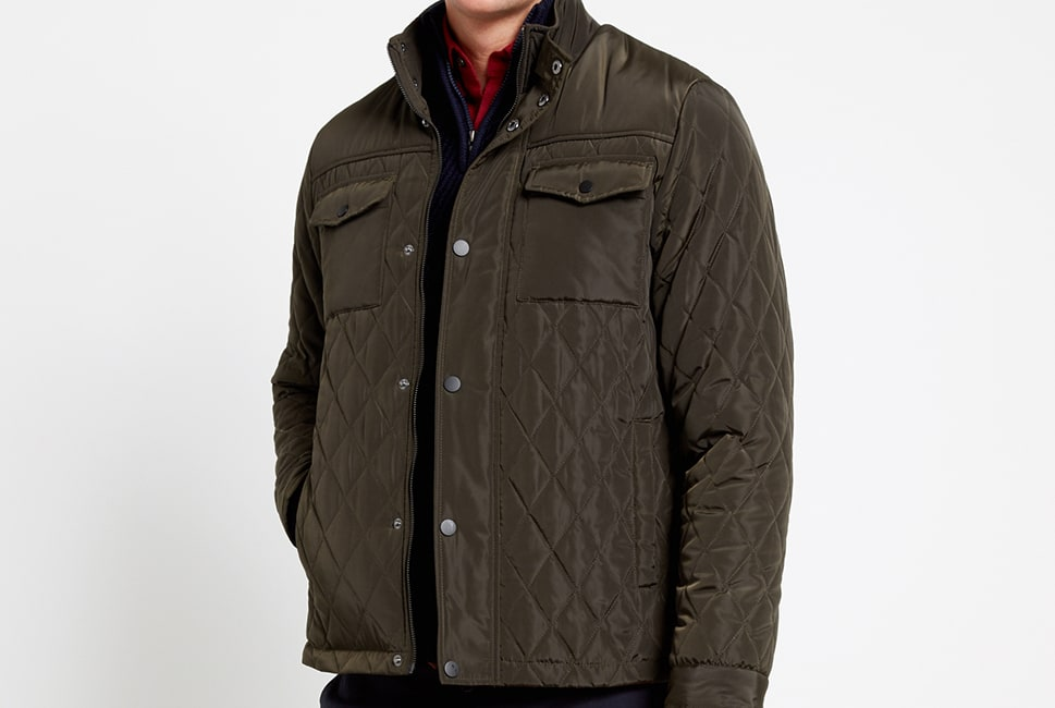 Olive quilted jacket with two breast pockets and silver buttons