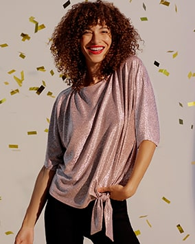 Silver shimmery top with elbow-length sleeves and side tie